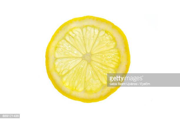 close-up of lemon slice on white background - zitrone stock-fotos und bilder