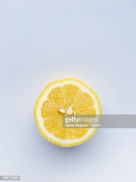 close-up of lemon slice over white background - zitrone stock-fotos und bilder