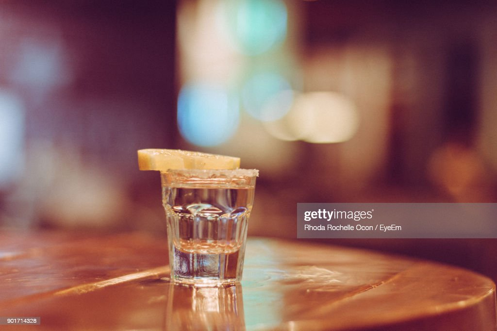 Close-Up Of Lemon Slice With Drink On Table : Stock Photo