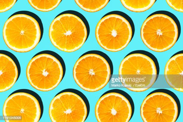 close-up of lemon slices on blue background - citrus fruit stock pictures, royalty-free photos & images