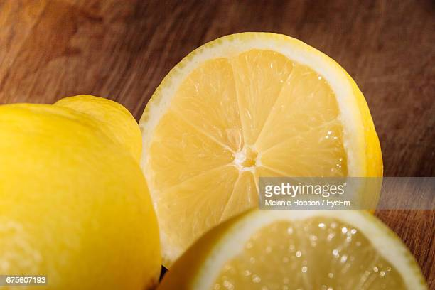 Close-Up Of Lemon Slices On Wooden Table