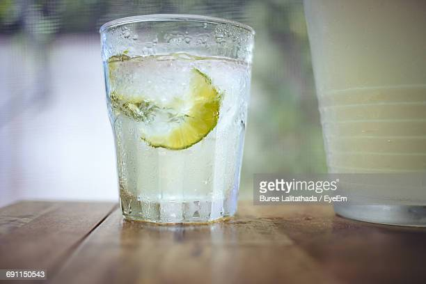close-up of lemon soda in glass on table - lemon soda stock pictures, royalty-free photos & images