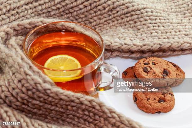 Close-Up Of Lemon Tea With Chocolate Chip Cookies On Table