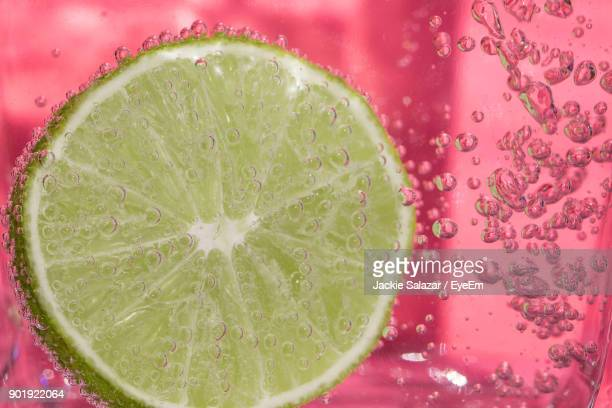 close-up of lemon with bubbles - tonic water stock pictures, royalty-free photos & images