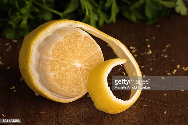Close-Up Of Lemon With Peel On Table
