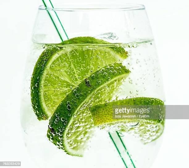 Close-Up Of Lemonade Against White Background