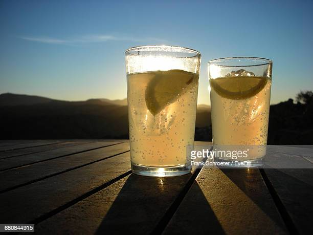 close-up of lemonade glass on table against sky on sunny day - lemon soda stock pictures, royalty-free photos & images