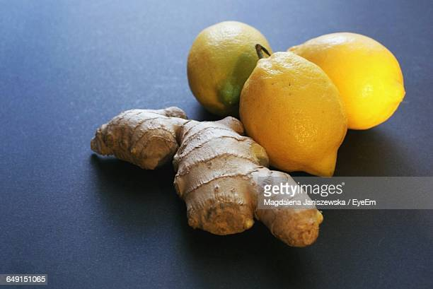Close-Up Of Lemons And Ginger On Table