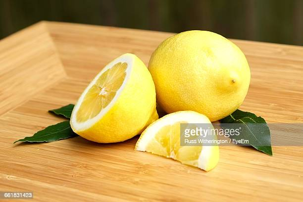 Close-Up Of Lemons On Wooden Table