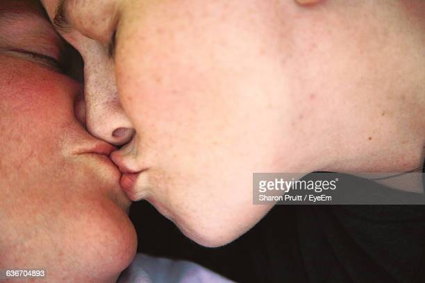 close-up of lesbian couple kissing - lesbian dating stock pictures, royalty-free photos & images
