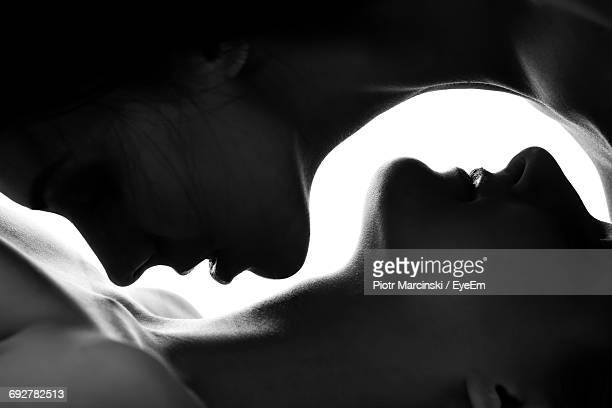 close-up of lesbians embracing each other - erotiek stockfoto's en -beelden