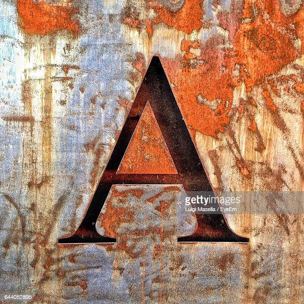 Close-Up Of Letter A On Rusty Metallic Wall