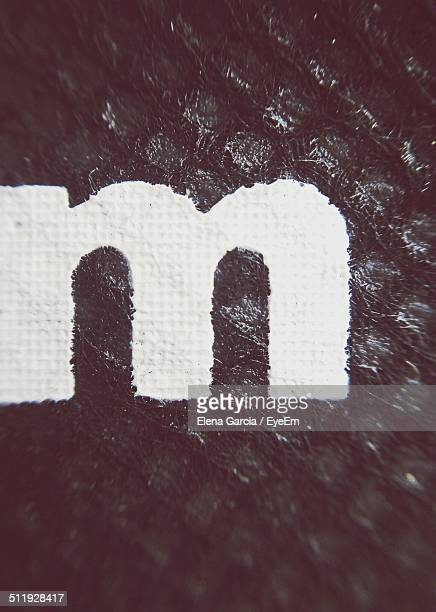 Close-up of letter M