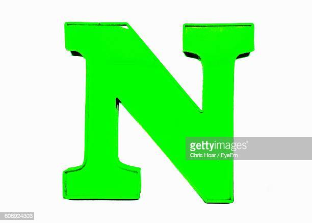 close-up of letter n against white background - letter n stock pictures, royalty-free photos & images