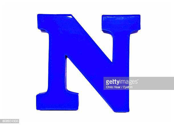Close-Up Of Letter N Against White Background