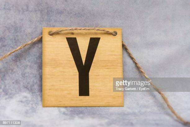 Close-Up Of Letter Y On Wood On Table