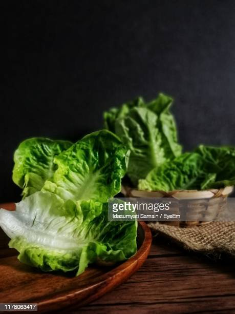 close-up of lettuce on table - lettuce stock pictures, royalty-free photos & images