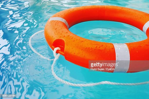Close-Up Of Life Belt Floating On Swimming Pool