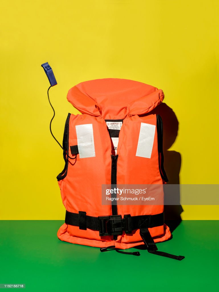 Close-Up Of Life Jacket Against Two Tone Background : Stock Photo