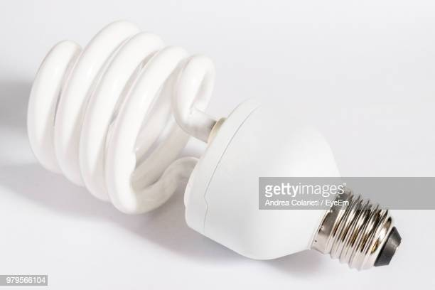 Close-Up Of Light Bulb On White Background