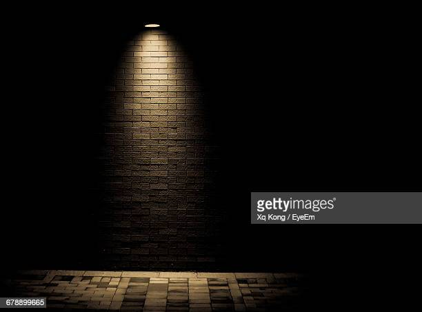 Close-up Of Light Falling On Brick Wall