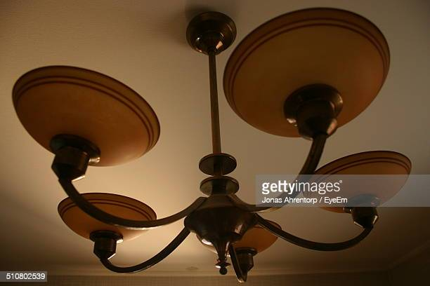 Close-up of light fixture on ceiling