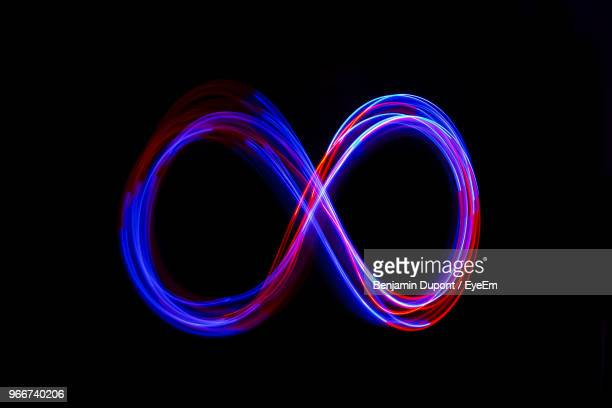 close-up of light painting against black background - lichtmalerei stock-fotos und bilder