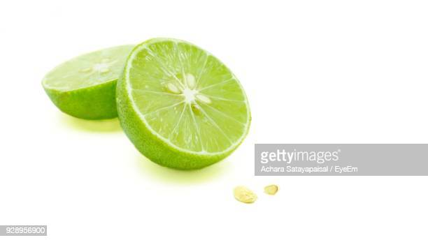 Close-Up Of Lime Against White Background