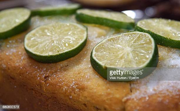 close-up of lime slices on gin and tonic cake - hutton stock photos and pictures