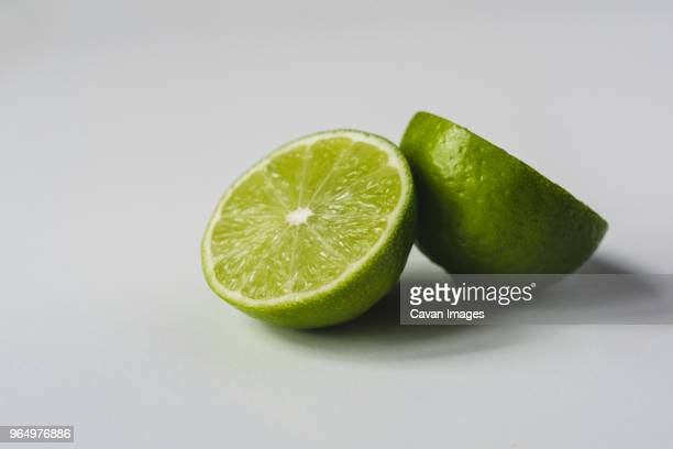 Close-up of lime slices on white background
