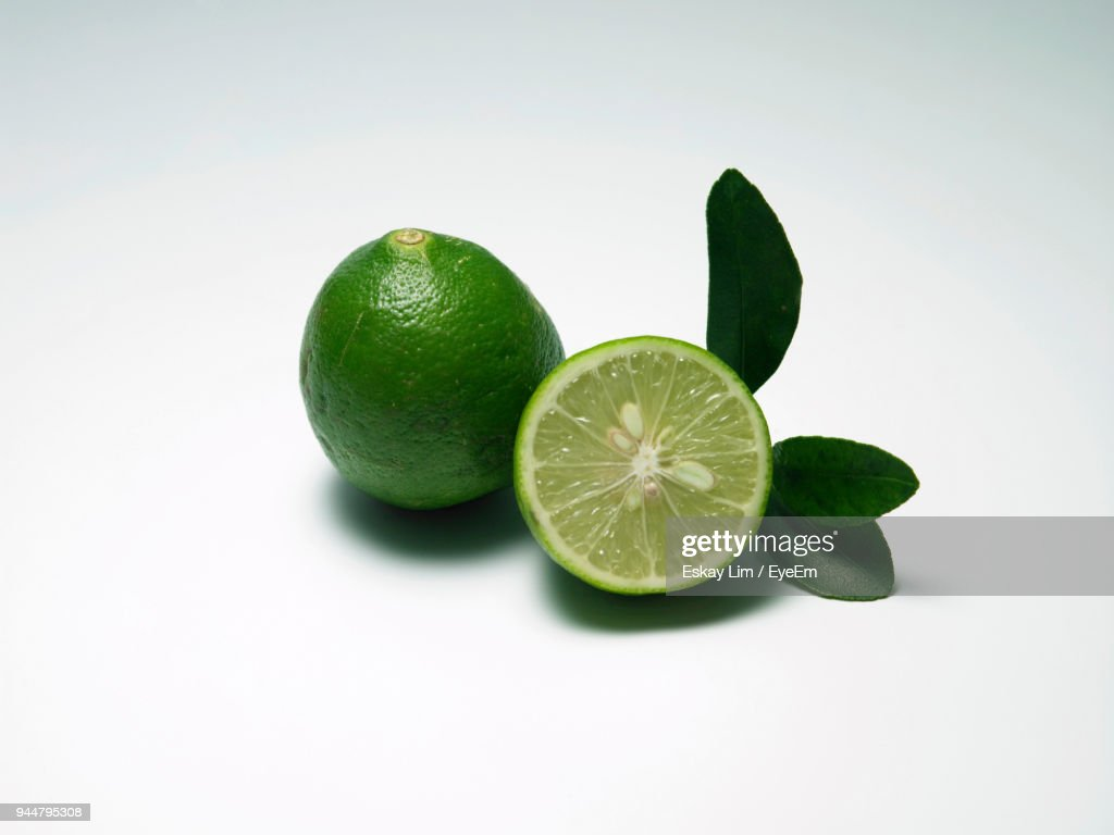 Close-Up Of Limes Against White Background : Stock Photo