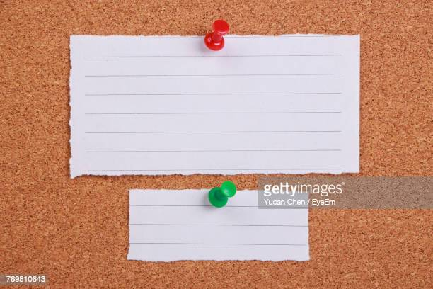 close-up of lined paper on bulletin board - bulletin board stock pictures, royalty-free photos & images