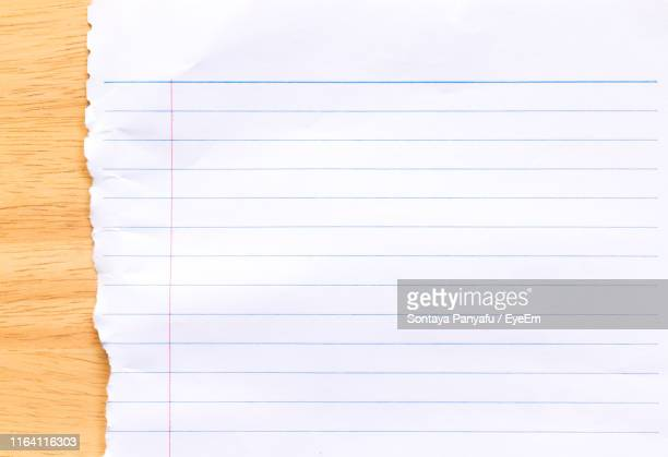 close-up of lined paper on table - lined paper stock pictures, royalty-free photos & images