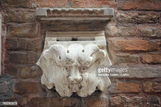 Close-Up Of Lion Sculpture On Brick Wall