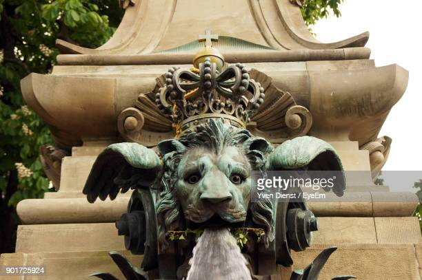 Close-Up Of Lion Shape Fountain