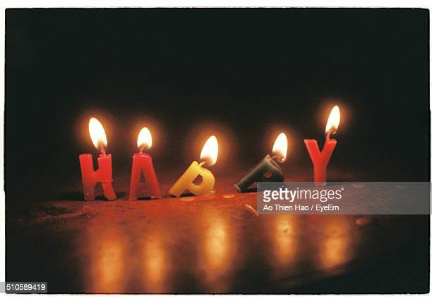 close-up of lit birthday candles in the dark - candle in the dark stock pictures, royalty-free photos & images