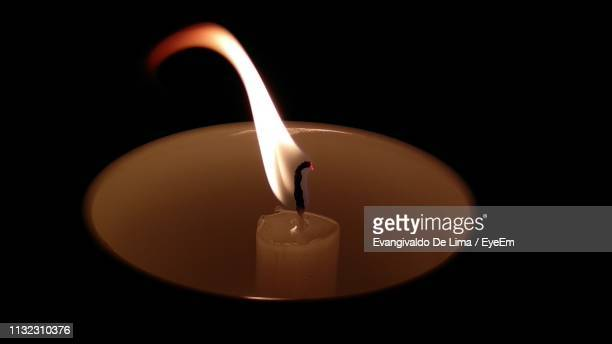 close-up of lit candle against black background - images of brazilian wax stock pictures, royalty-free photos & images