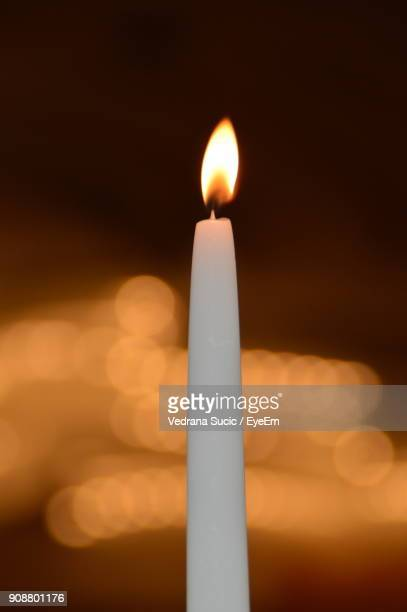 Close-Up Of Lit Candle At Night