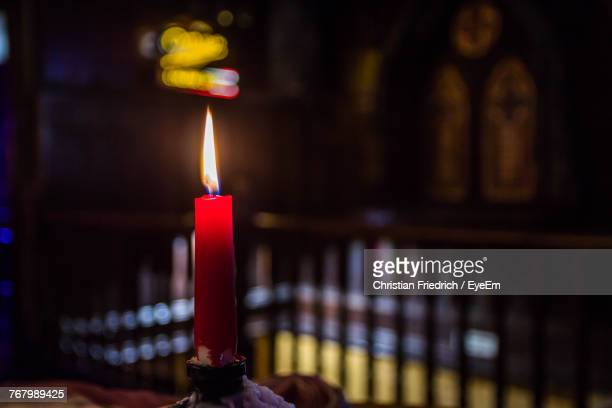Close-Up Of Lit Candle In Church