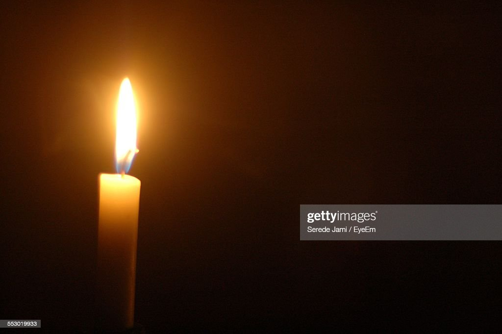 Close-Up Of Lit Candle In The Dark : Stock Photo