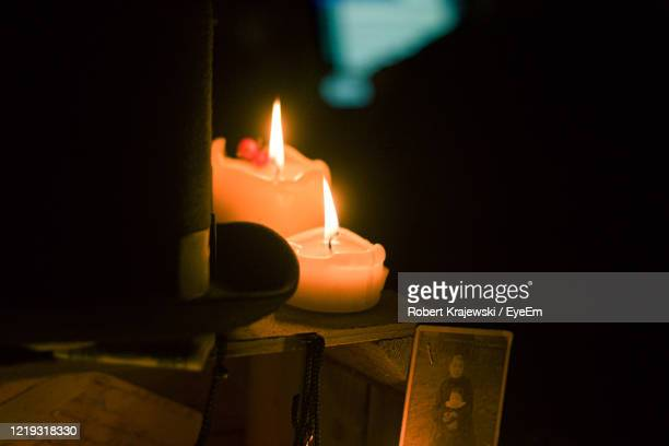 close-up of lit candles in darkroom - candlelight stock pictures, royalty-free photos & images