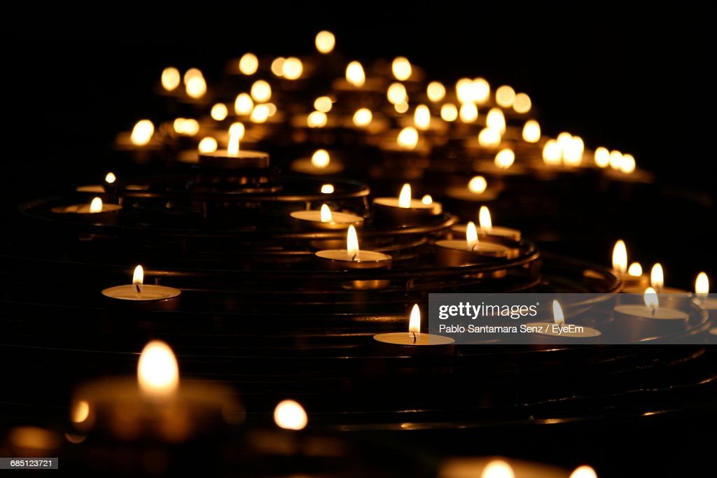 Close-Up Of Lit Candles In Row : Stock Photo