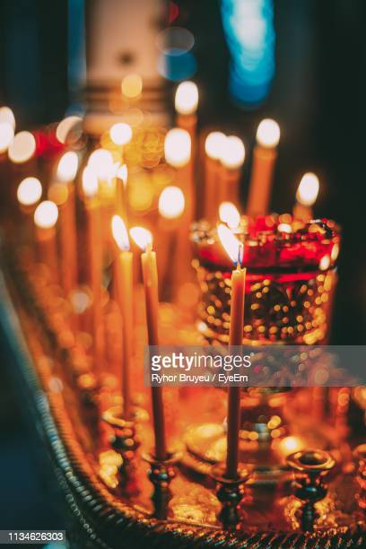 close-up of lit candles in temple - osterfeuer stock-fotos und bilder