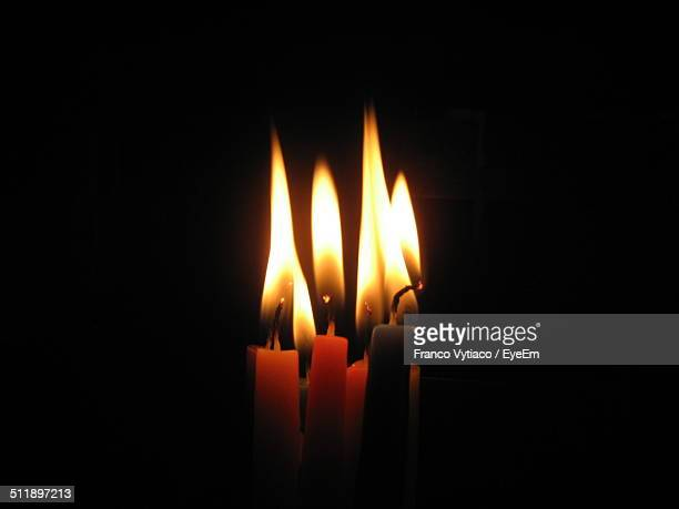 close-up of lit candles in the dark - candle in the dark stock pictures, royalty-free photos & images
