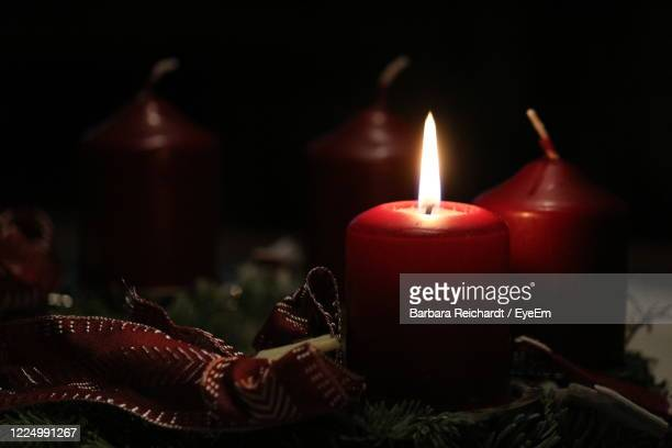 close-up of lit candles on table - christmas decore candle stock pictures, royalty-free photos & images