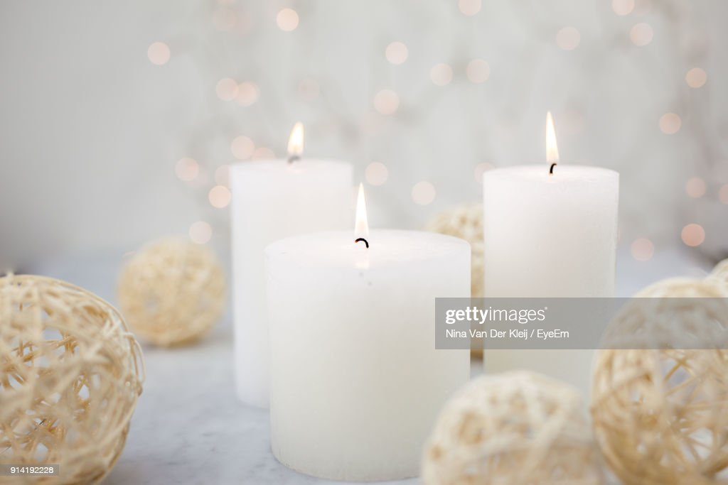 Close-Up Of Lit Candles On Table : Stockfoto