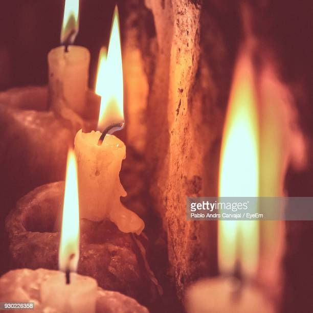 close-up of lit candles - carvajal stock photos and pictures