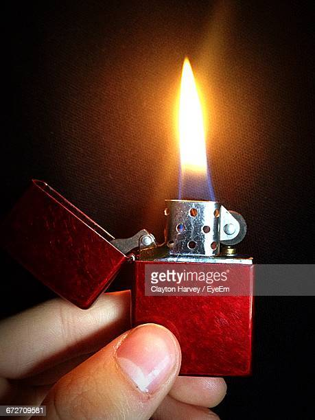 close-up of lit cigarette lighter - cigarette lighter stock pictures, royalty-free photos & images
