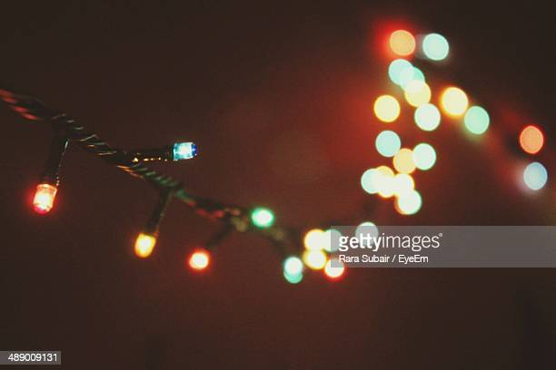 close-up of lit colorful lights - christmas lights stock pictures, royalty-free photos & images