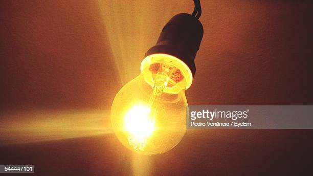Close-Up Of Lit Light Bulb